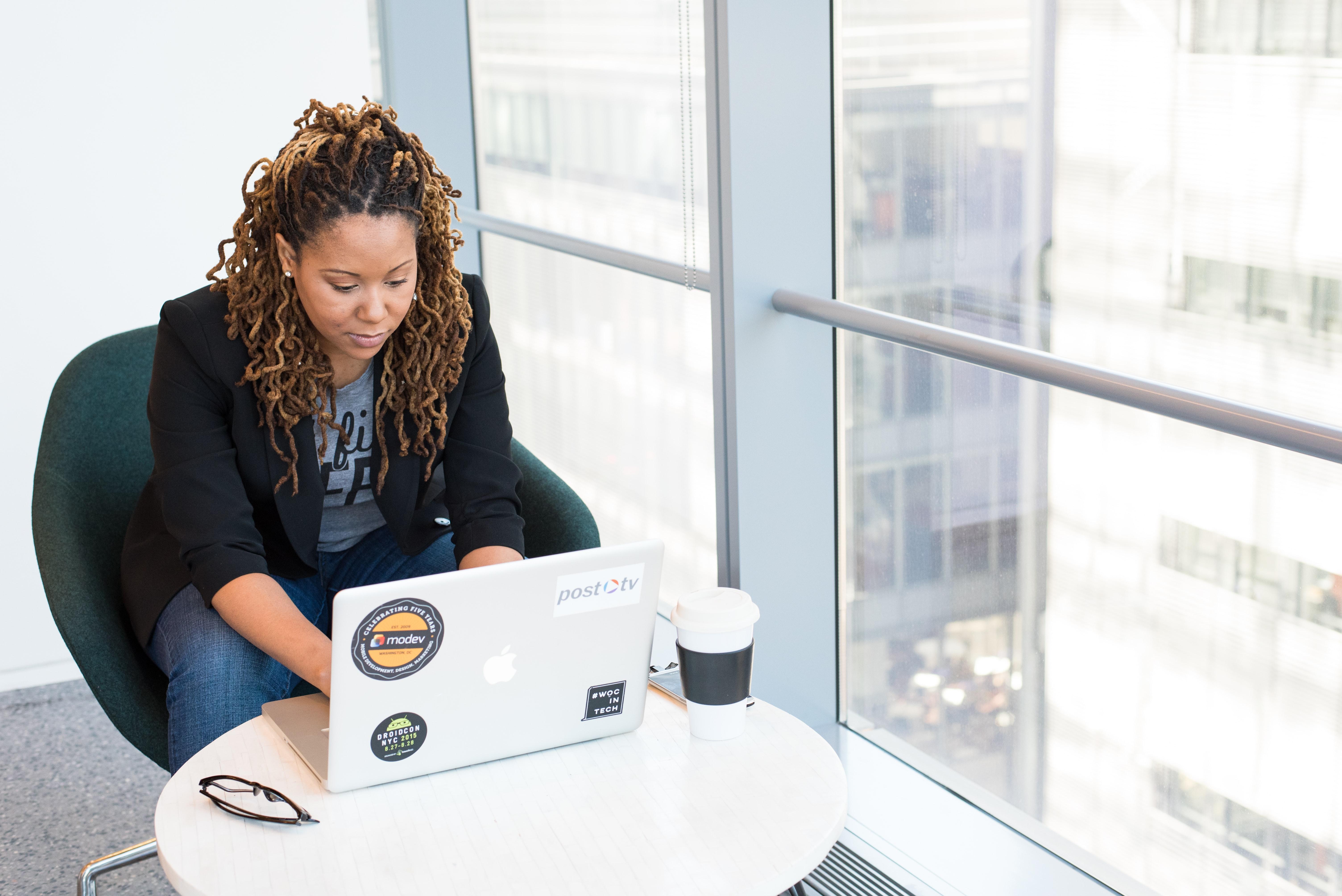 women writing on laptop
